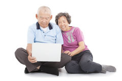 Happy senior couple watching or leaning with laptop Royalty Free Stock Images