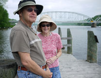 Happy Senior Couple at waterfront. A mature senior citizen couple enjoying the golden years on the riverfront, Connecticut River, East Haddam, CT royalty free stock images