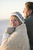 Happy senior couple wearing winter hat and sweater Royalty Free Stock Photos