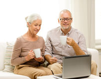 Free Happy Senior Couple With Laptop And Cups At Home Royalty Free Stock Photography - 45875097