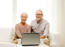 Free Happy Senior Couple With Laptop And Cups At Home Stock Photography - 45875132