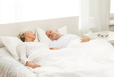 Happy senior coupler lying in bad at home Stock Photo