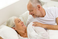 Happy senior coupler lying in bad at home Stock Photos