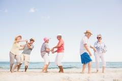 Happy senior couples dancing Stock Photo