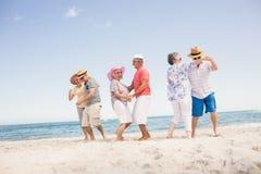 Happy senior couples dancing Stock Image