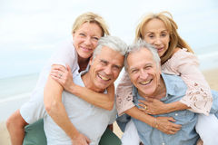 Happy senior couples enjoying on the beach Royalty Free Stock Photo
