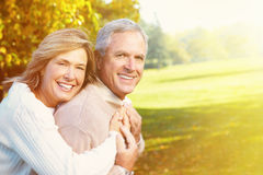 Happy senior cuople. Happy senior couple having fun together in park royalty free stock image