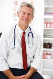Happy senior doctor in consultation room Royalty Free Stock Photography
