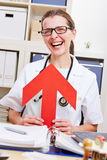 Happy senior doctor pointing arrow to herself Stock Photography