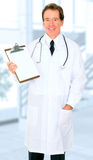 Happy Senior Doctor Showing Empty Board Royalty Free Stock Photography