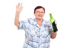 Happy senior drunk woman Stock Images