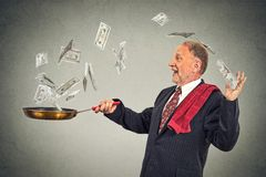 Happy senior elderly business man juggling money dollar bills Royalty Free Stock Image