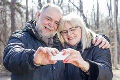 Happy Senior Elderly Couple taking Selfie Stock Photos