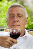 Happy senior enjoying drink Stock Photo