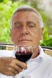 Happy senior enjoying drink Stock Photo