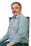 Happy senior executive man on chair Royalty Free Stock Photos
