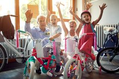 Senior family buying new bicycle for little grandchildren. Happy senior family buying new bicycle for little grandchildren stock photos