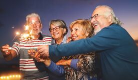 Free Happy Senior Family Celebrating With Sparkler Fireworks At Home Party Stock Image - 199282811