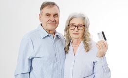 Happy senior family couple with credit card payment isolated on white background. Close up portrait woman and man with wrinkled. Happy senior family couple with royalty free stock photo