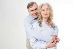 Happy senior family couple  on white background. Close up portrait woman and man with wrinkled face. Elderly grandparents royalty free stock image