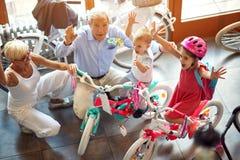 Happy senior family with grandchildren buying new bicycle. Happy senior family with little grandchildren buying new bicycle royalty free stock photo