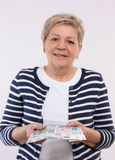 Happy senior female counting polish currency money, concept of financial security in old age Royalty Free Stock Image