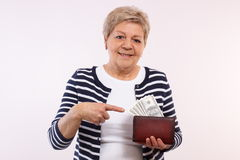 Free Happy Senior Female Showing Dollar Currencies In Wallet, Concept Of Financial Security In Old Age Stock Photo - 66231370