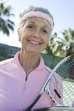 Happy Senior Female Tennis Player Stock Photos