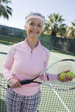 Happy Senior Female Tennis Player royalty free stock image