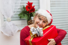 Happy senior with a gift Royalty Free Stock Images