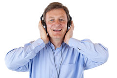 Happy senior with headphones listens to mp3 music Royalty Free Stock Image