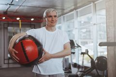 Senior man working out at the gym stock photography