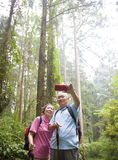 Happy senior hiking in the park Royalty Free Stock Photography