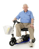 Happy Senior on His Scooter Royalty Free Stock Image