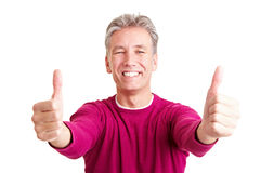 Happy senior holding both thumbs up Stock Photo