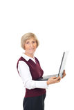 Happy senior holding laptop. Happy senior woman holding laptop isolated on white background stock images