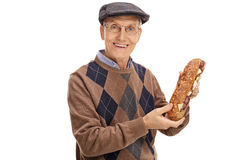 Happy senior holding a sandwich Royalty Free Stock Photography