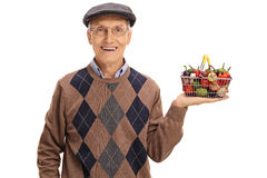Happy senior holding a small shopping basket Royalty Free Stock Photography