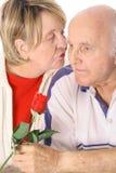 Happy senior kisses Stock Photos