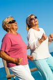 Happy senior ladies jogging together. Stock Image