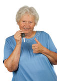Happy senior lady with a car key Stock Photography