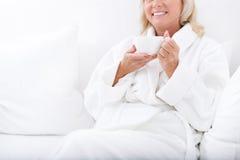 Happy senior lady enjoying vacation stock photo