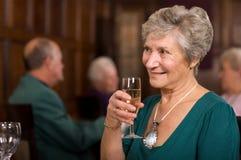 Happy senior lady in restaurant Stock Photos