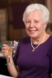 Happy senior lady in restaurant Royalty Free Stock Images