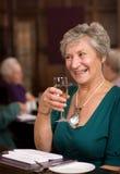 Happy senior lady in restaurant Royalty Free Stock Photo
