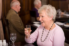 Happy senior lady in restaurant Stock Photos