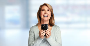 Happy senior lady with smartphone Stock Photo