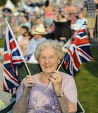 Happy Senior Lady Waves British Flags Royalty Free Stock Images