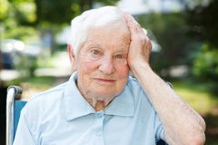 Happy senior lady in wheelchair Royalty Free Stock Images