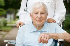 Happy senior lady in wheelchair Stock Photos